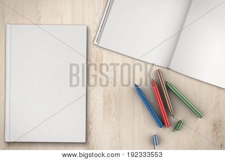 blank white book with pen top view