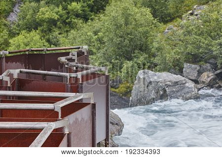 Norwegian river and labyrinth viewpoint. Forest and waterfall. Norway trekking