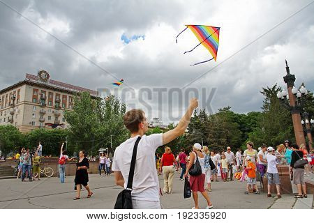 Volgograd Russia - June 12 2014: Man launches a kite into the sky at the kite festival in Volgograd