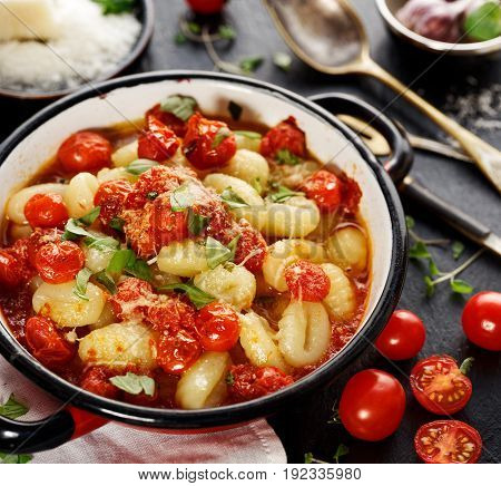 Potato gnocchi with cherry tomato sauce, parmesan cheese and fresh basil.  Delicious and nutritious italian meal