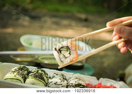 Picnic. Sushi outdoors on a summer day. Day off in the park