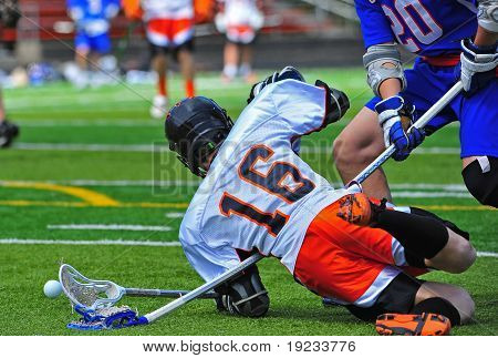 Boys High School Lacrosse player falls down on a stick. poster
