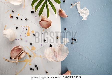 Garlic Cloves On A Beautiful Watercolor Background Of White And Blue..