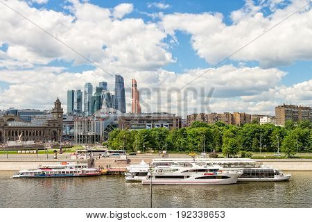 MOSCOW RUSSIA - JUNE 6 2017: Terminal for tourist ships Europe Square with skyscrapers of the international business center