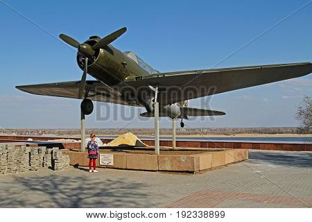 Volgograd Russia - April 12 2015: The girl is standing near airplane SU-2 (BB-1) in Volgograd