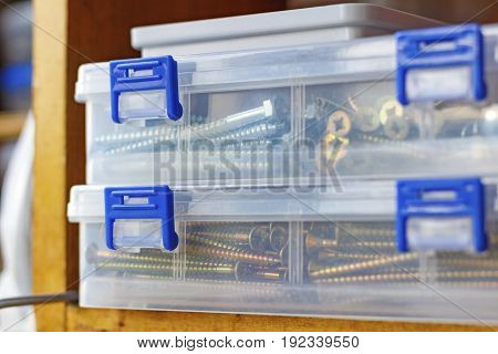 Long Self-tapping Screws In Transparent Plastic Storage Box On The Shelf In Workshop