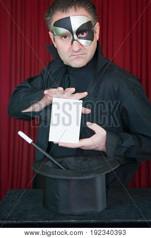 Illusionist Presents Blank Card, Color Image, Red Background