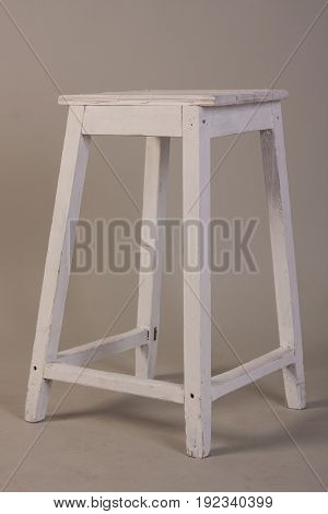Old Wooden White Stool On A Gray Background