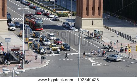 Pedestrians crossing the road on the Placa Espanya in Barcelona Catalonia Spain July 2016