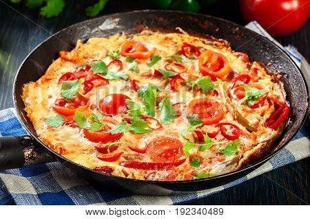 Frittata Made Of Eggs, Sausage Chorizo, Red Pepper, Green Pepper, Tomatoes, Cheese And Chili In A Pa