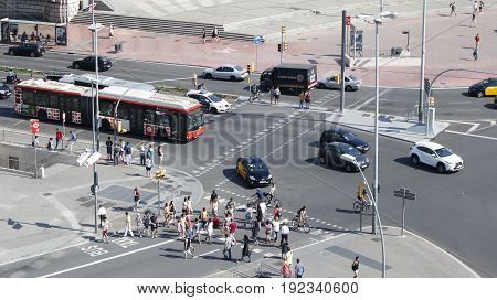 Barcelona traffic cars buses and pedestrians on a sunny day Spain July 2016