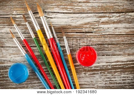 paint brushes on wooden background special tools for creative people back to school education background