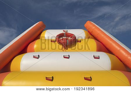 multicolored inflatable slide for kids and blue sky