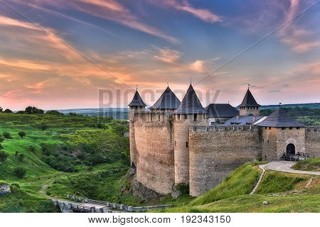 Dawn fortress bastion of the Dniester River in Khotin on a background of dawn of the legends of history of Ukraine in Eastern Europe