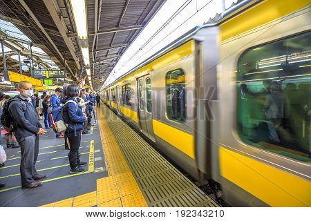 Tokyo, Japan - April 17, 2017: Chuo Line for Akihabara, the yellow line of JR Line, a rail service that crosses east-west Tokyo downtown, arriving at Shinjuku Station, Tokyo's main station.
