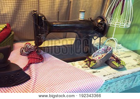 Old Tailor Workshop With Sewing Machine,