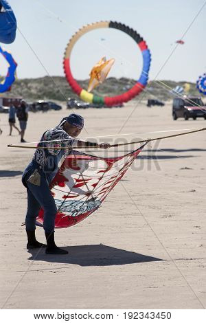 FANOE DENMARK JUNE 17 2017: Kite flyer from Japan is ready to let the kite rise on Fanø beach. Fanoe Kite Fliers Meeting June 2017.