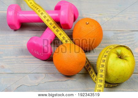 Fruits With Dumbbells Weight And Measuring Tape On Blue Vintage