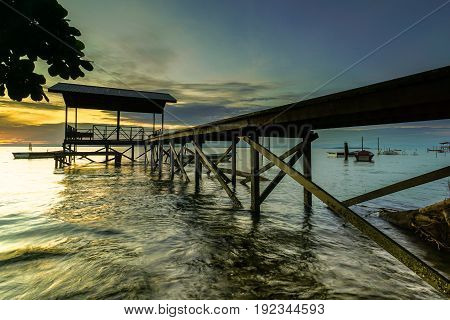 Dramatic sky & peaceful of mind in the early of morning in the fishing jetty with the fishing boats in Tanjung Aru village,Labuan island,Malaysia