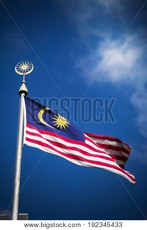 Malaysia flag with national symbol on flagpole
