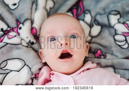 Funny funny kid with big blue eyes, laughing baby