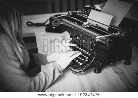 Secretary At Old Typewriter With Telephone. Young Woman Using Typewriter. Business Concepts. Retro P