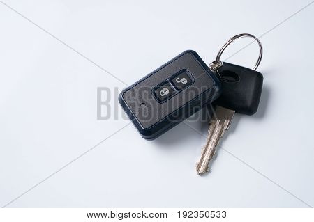 Car key and alarm system charm isolated on a white background with copy spase. car key with remote control