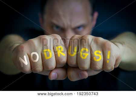 No Drugs Written On An Angry Man's Fists