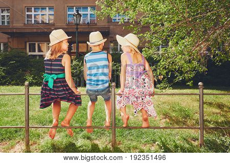 Three Sibling In The Public Park