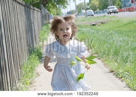 Carefree and playful little girl running inl dress at summer happy smiling child children activity