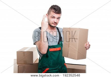 Mover Guy Holding Cardboard Box Showing Fingers Crossed