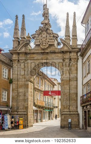 BRAGA,PORTUGAL - MAY 14,2017 - The Arch of Rua Souto (Porta Nova) in the streets of Braga in Portugal. Braga was under the Roman Empire known as Bracara Augusta.
