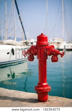 Marine fire hydrant on the quay in front of the yachts, the Mediterranean sea, Greece