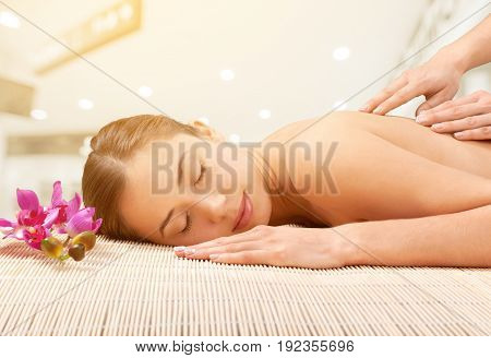 Woman salon spa treatment having young adult background