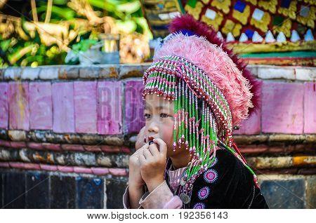 DOI SUTHEP, THAILAND - DECEMBER 22, 2012: Thai kid in Doi Suthep Temple near Chiang Mai in Thailand
