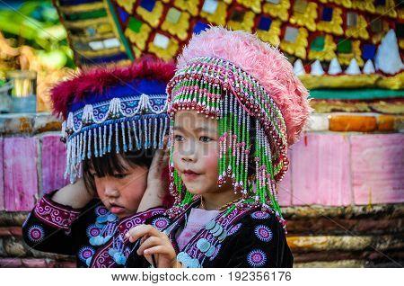 DOI SUTHEP, THAILAND - DECEMBER 22, 2012: Thai kids in Doi Suthep Temple near Chiang Mai in Thailand