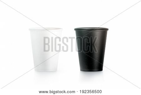 Blank black and white disposable paper cup mock up isolated 3d rendering. Empty polystyrene coffee drinking mug mockup front view. Clear plain tea take away plastic package cofe branding template.