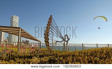 NETANYA, ISRAEL - AUGUST 29, 2015: Modern promenade with paraglider sculpture on Mediterranean sea coast, Netanya, Israel. Coast and quay of Netanya is popular place for paragliding