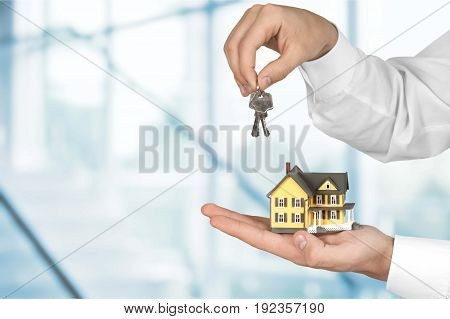 Holding model hands house key closeup business