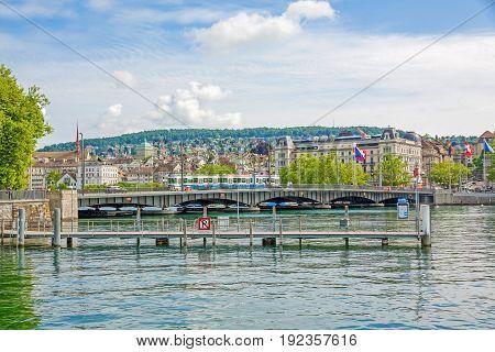 Zurich Switzerland - June 10 2017: Zurich Quaibrucke bridge with tram river Limmat / Lake Zurichsee - view from quare Burkliterrasse towards Bellevueplatz square