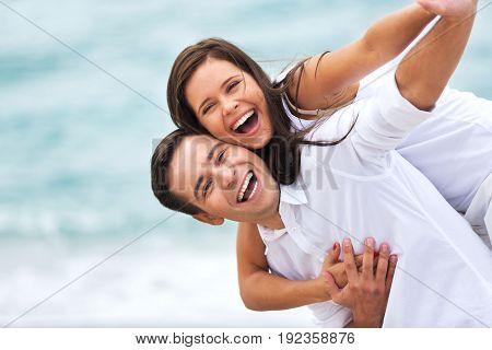 Happy young couple fun blue beautiful day