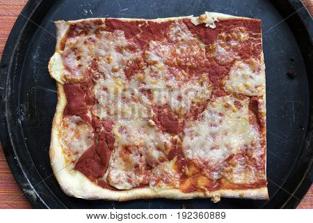piece of homemade margherita pizza on a baking tray
