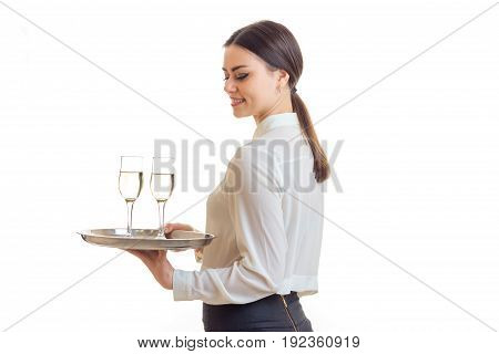 Cutie young waitress smiles and holds a tray isolated on white background