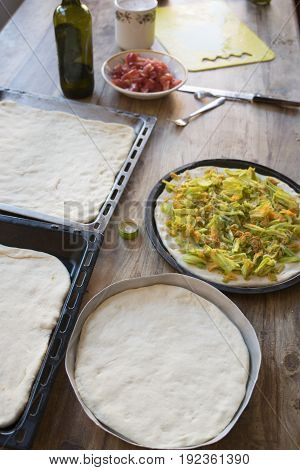 preparing pizza at home with variety of tastes