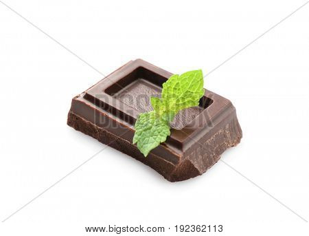 Broken chocolate piece with mint leaves, isolated on white