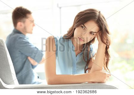 Sad young woman after quarrel with boyfriend