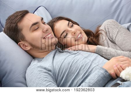 Beautiful young couple at home
