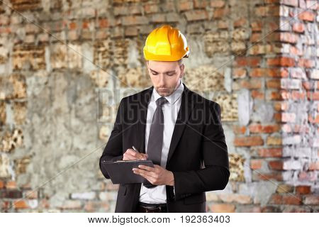 Insurance adjuster in abandoned building