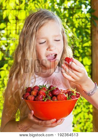 Girl with fruit, berry at garden