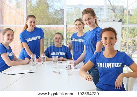 Meeting of young volunteers team in office
